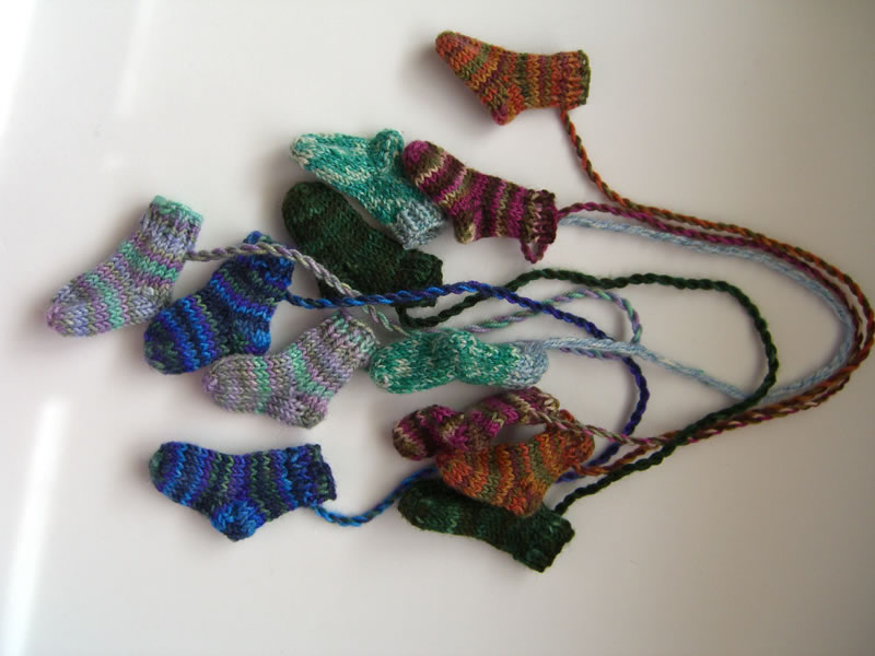 http://www.persistentillusion.com/blogblog/fo/a-dozen-teeny-tiny-socks