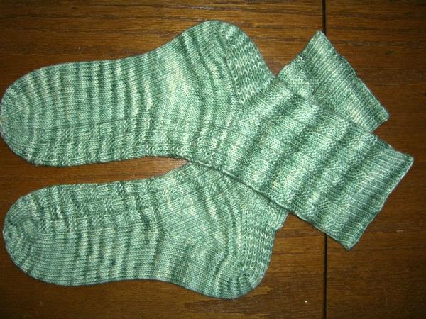 http://www.persistentillusion.com/blogblog/fo/basket-weave-socks