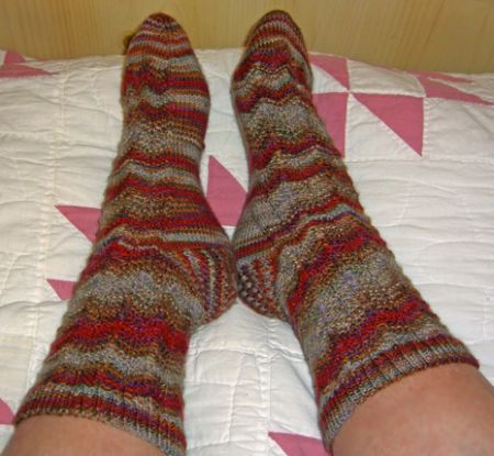 http://www.persistentillusion.com/blogblog/fo/rooster-feather-socks