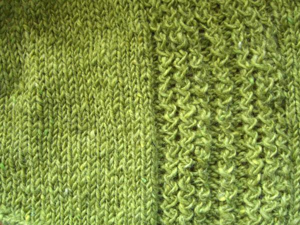 green shirttail sweater