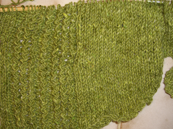 green shirttail sweater